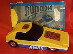 Soviet toy radio-controlled car Turn 1984 with remote control. USSR